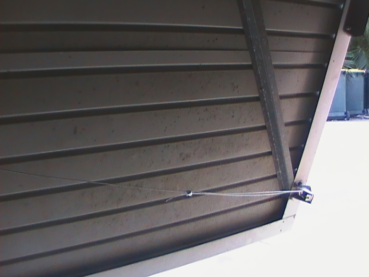 Tilt-a-Door Wire and One of the Catches