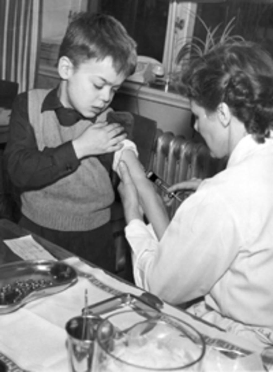 A boy receives a polio vaccination