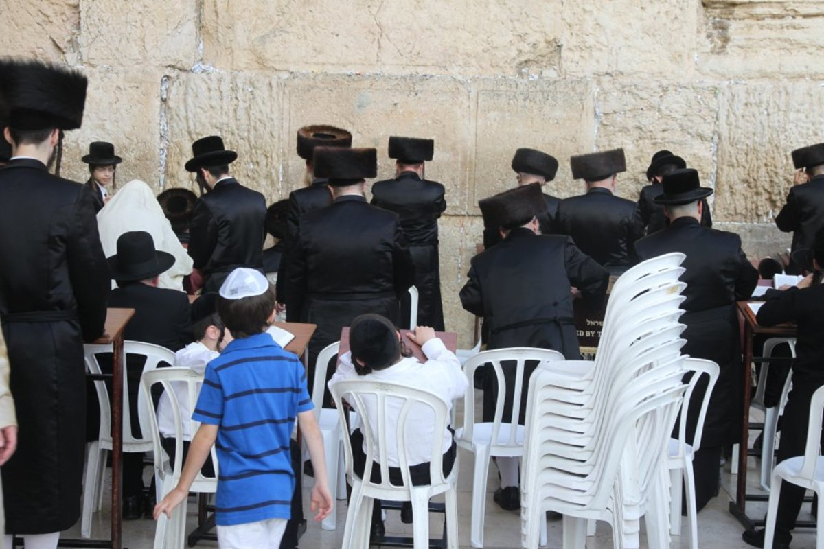 Jewish Men Pray at Western Wall in Jerusalem