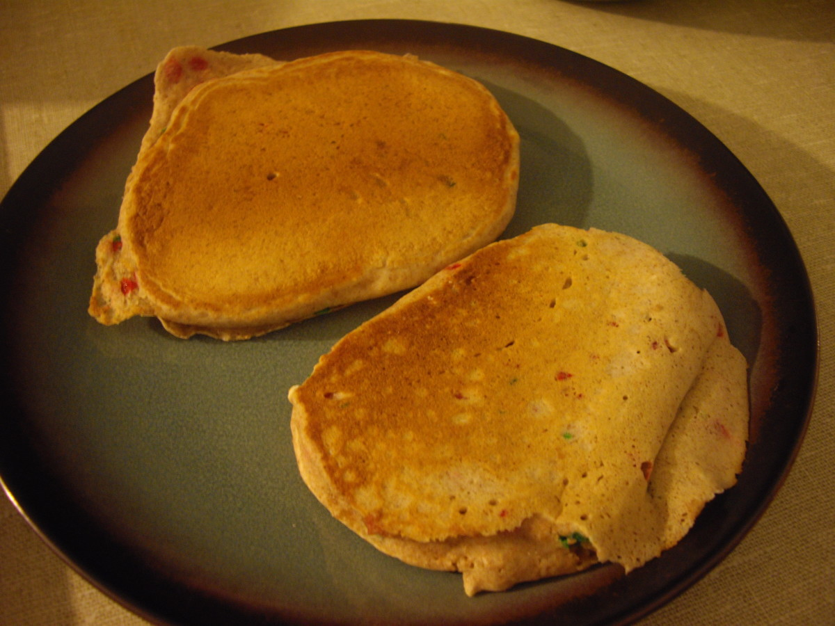 Two completed pancakes, nicely browned