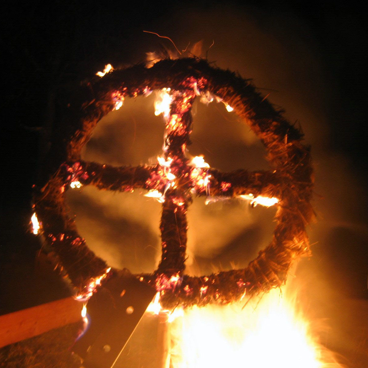 A burning sun wheel at a winter solstice (Yule) celebration.