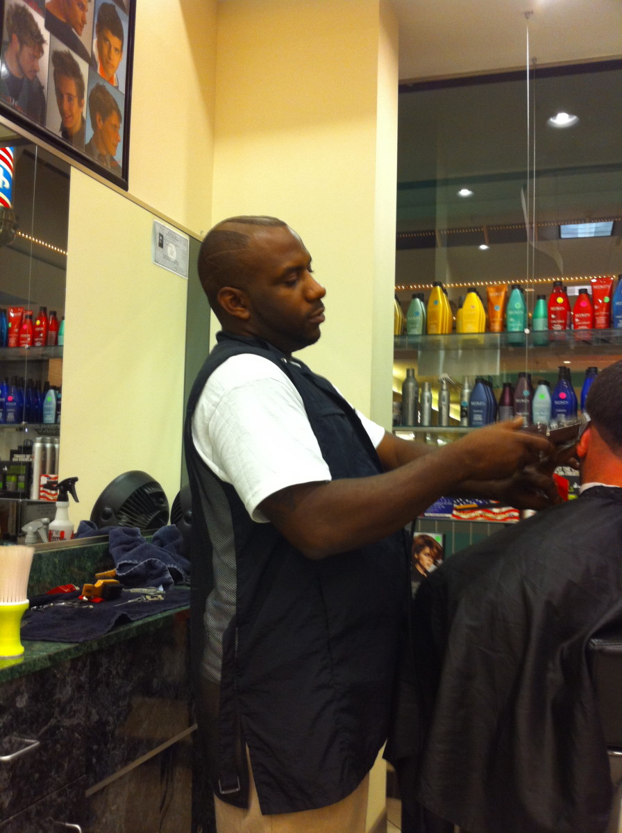 Terrance doing what he loves and the Unisex Hair Palace in the Pougkeepsie Galleria.