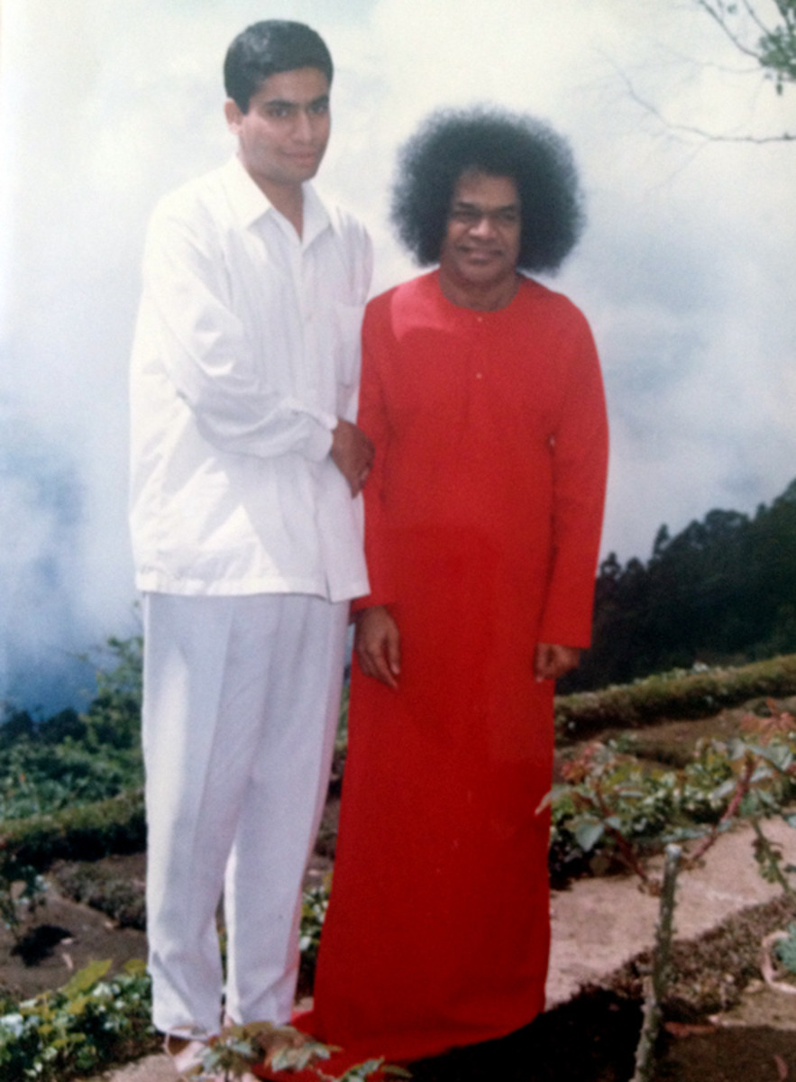 Pushkaraj Gumaste with his master, Bhagawan Sri Sathya Sai Baba, during a trip to Kodaikanal in 1993.