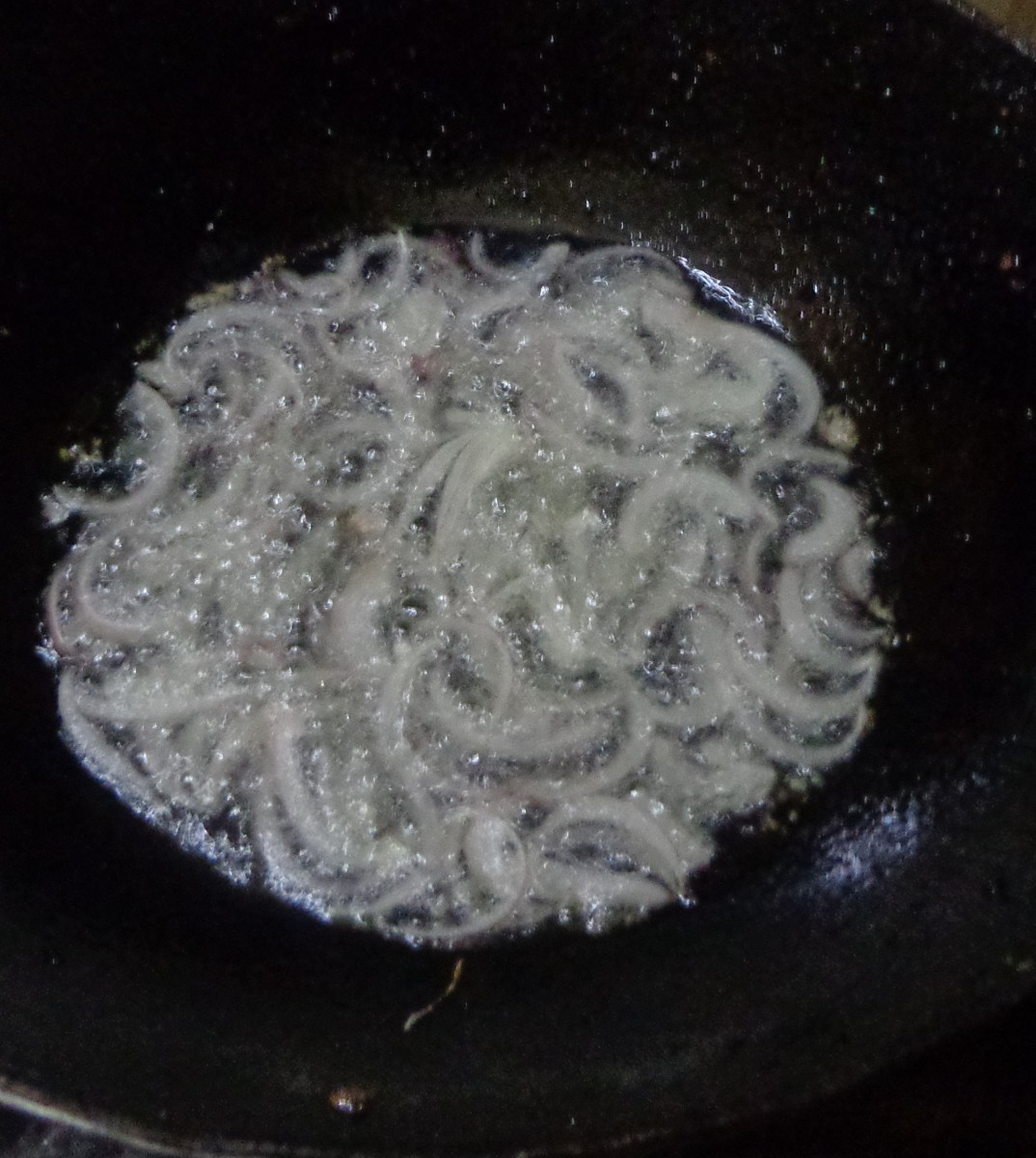 Onions getting fried in the oil