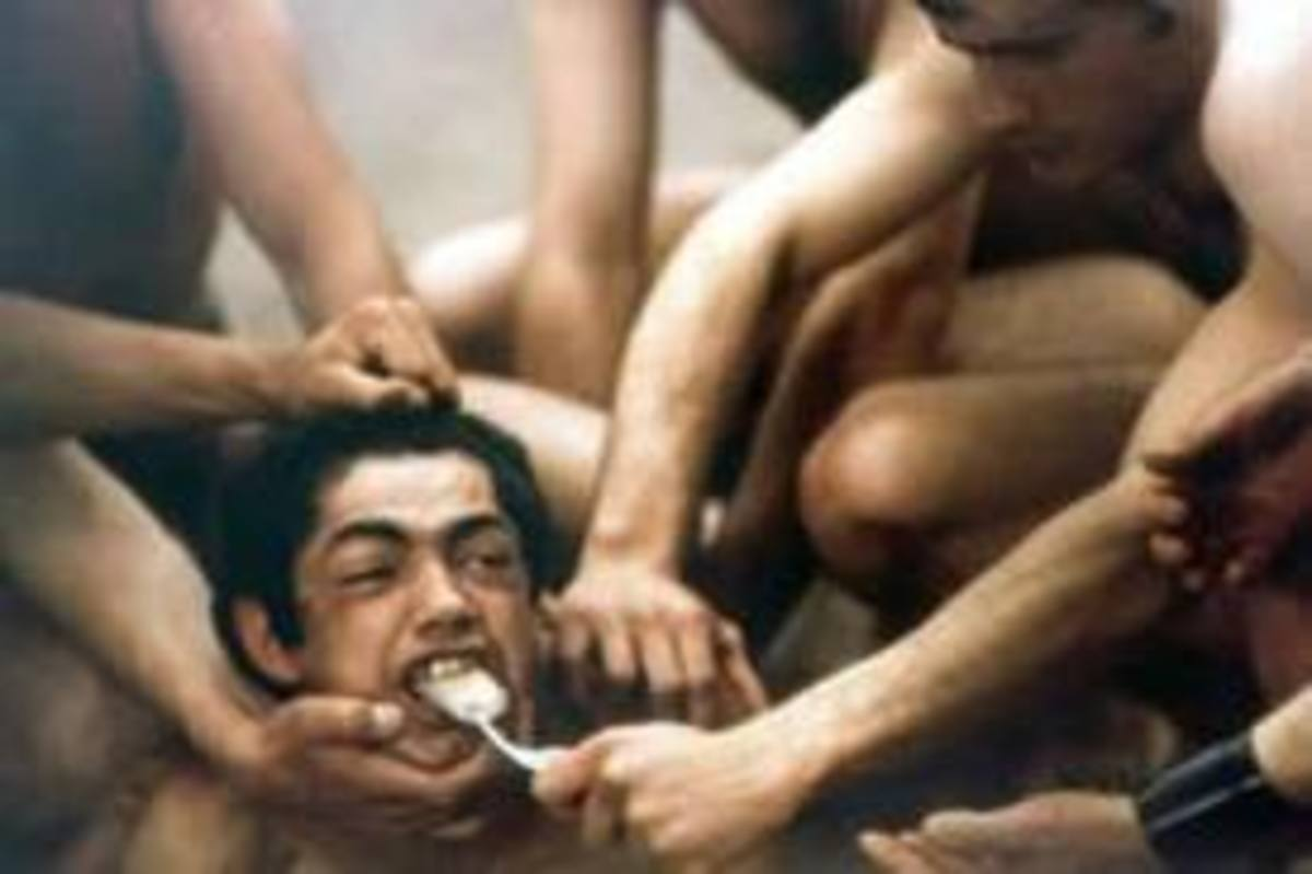 A shot from Salo.  This is one of the many scenes in which teens are tortured for the amusement of the of the 4 fascists.