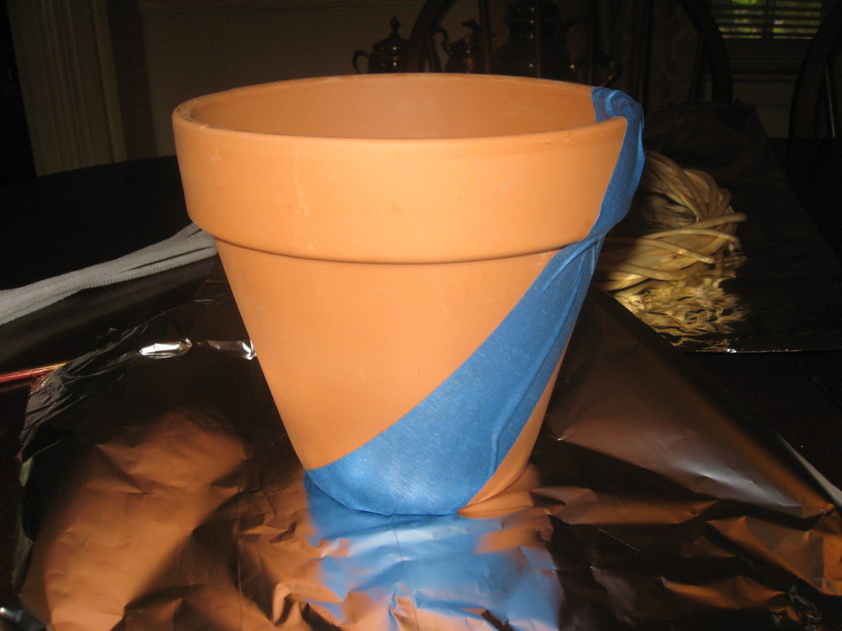 I used painter's tape and craft paint on this clay pot.