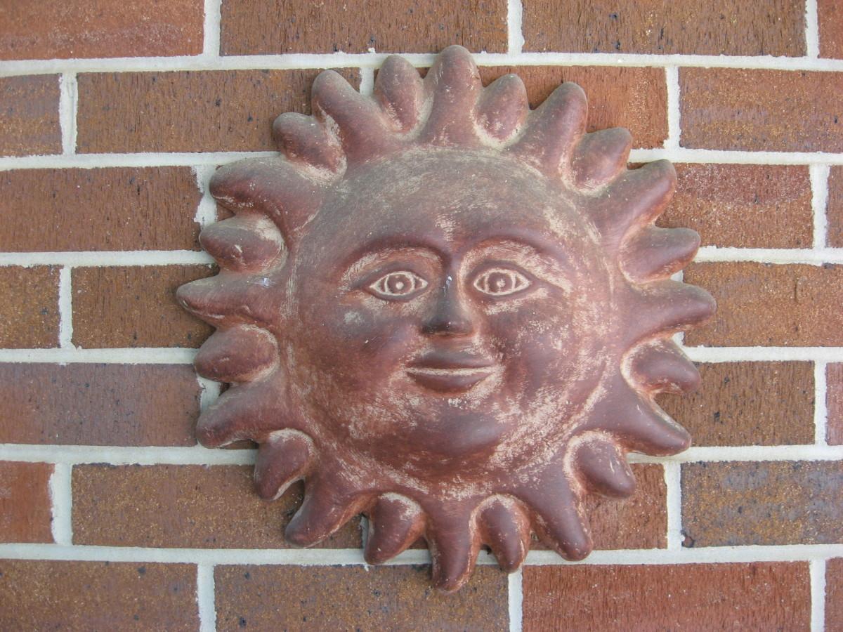 ceramic sun sculpture