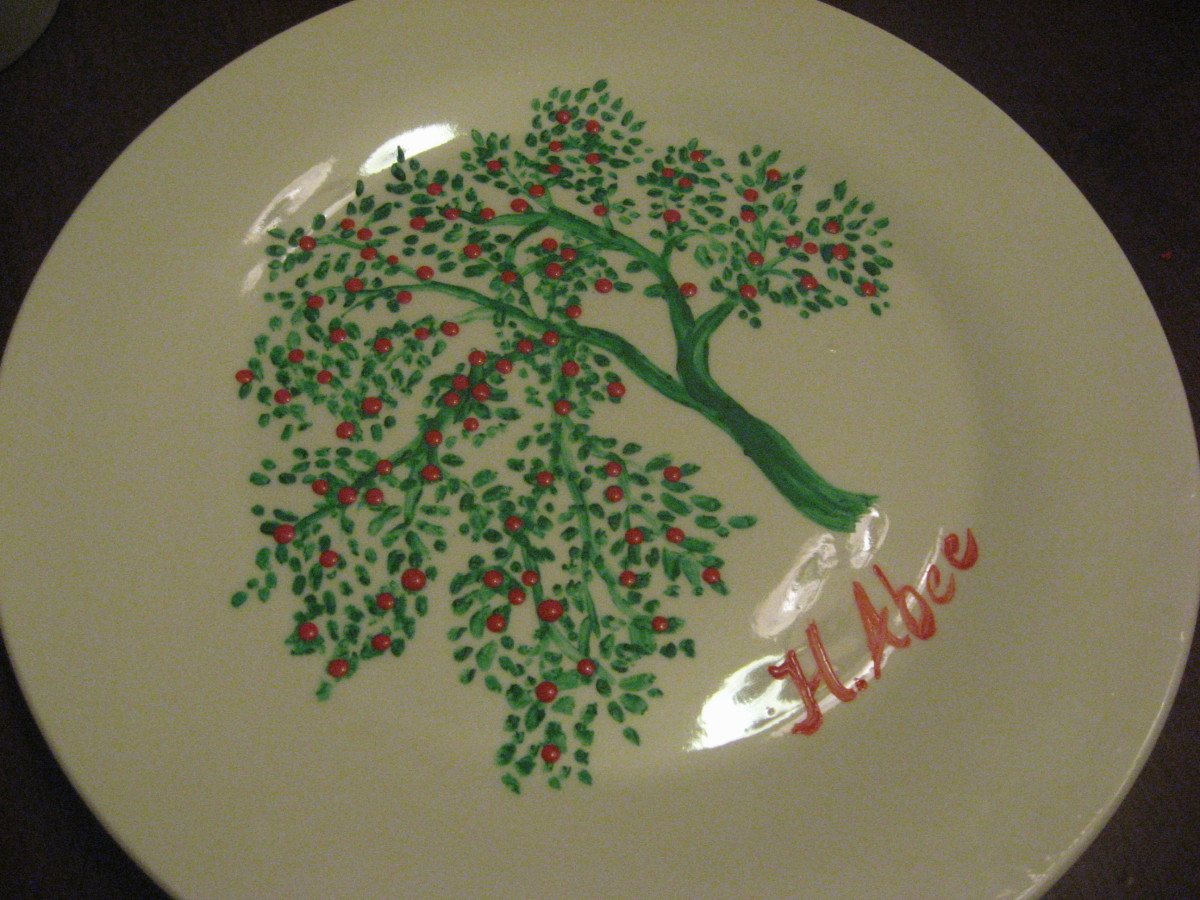 This plain white plate was $1. I added the green branch with acrylic paint.
