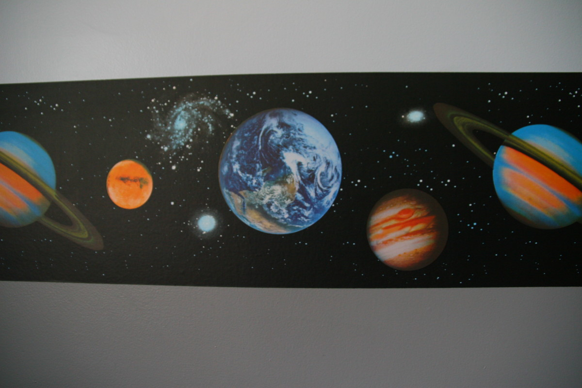 Add wallpaper border to add interest to a space-themed bedroom. Many different styles exist.