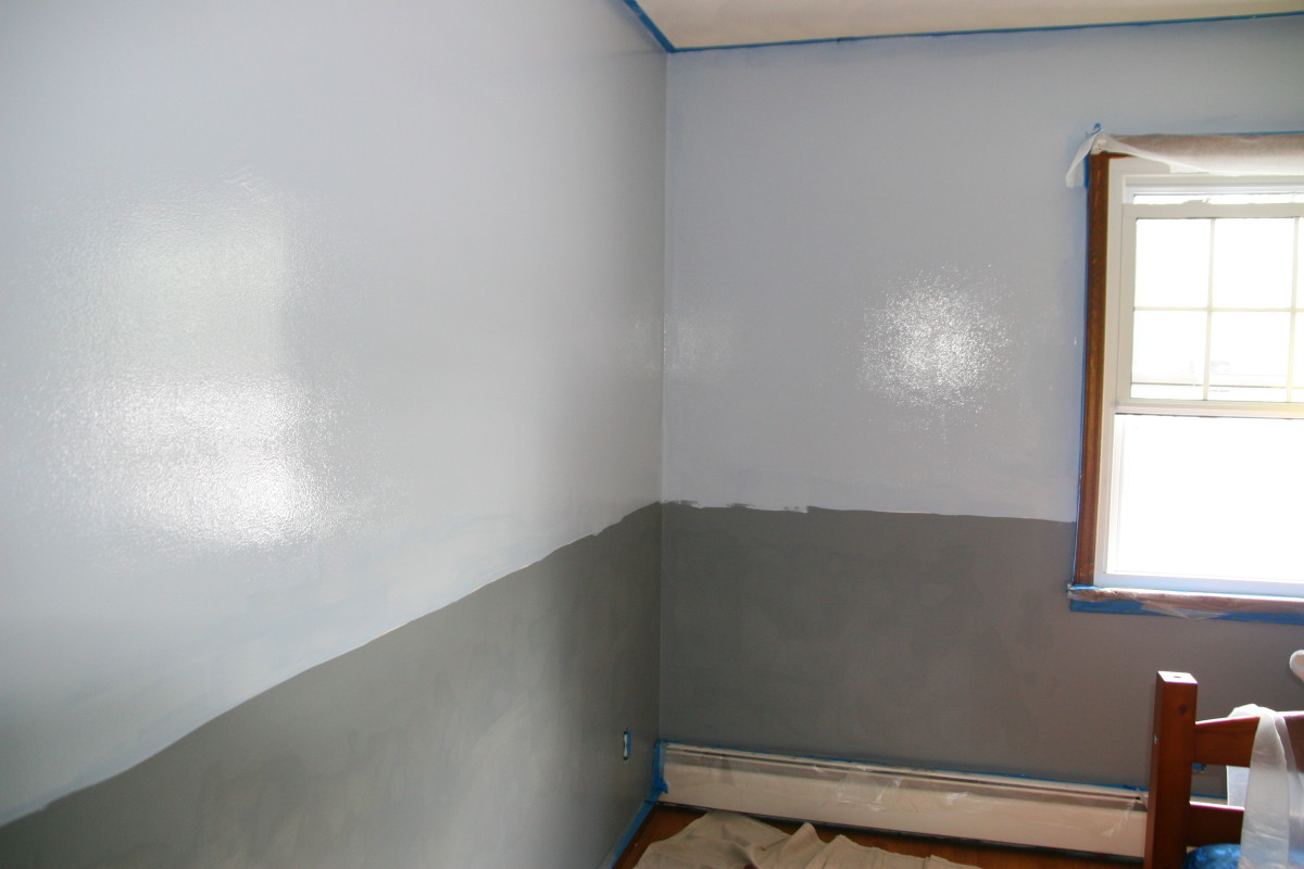 The blue and gray paint have been applied. Since a border will cover the line, we did not use painter's tape to create a neat edge.