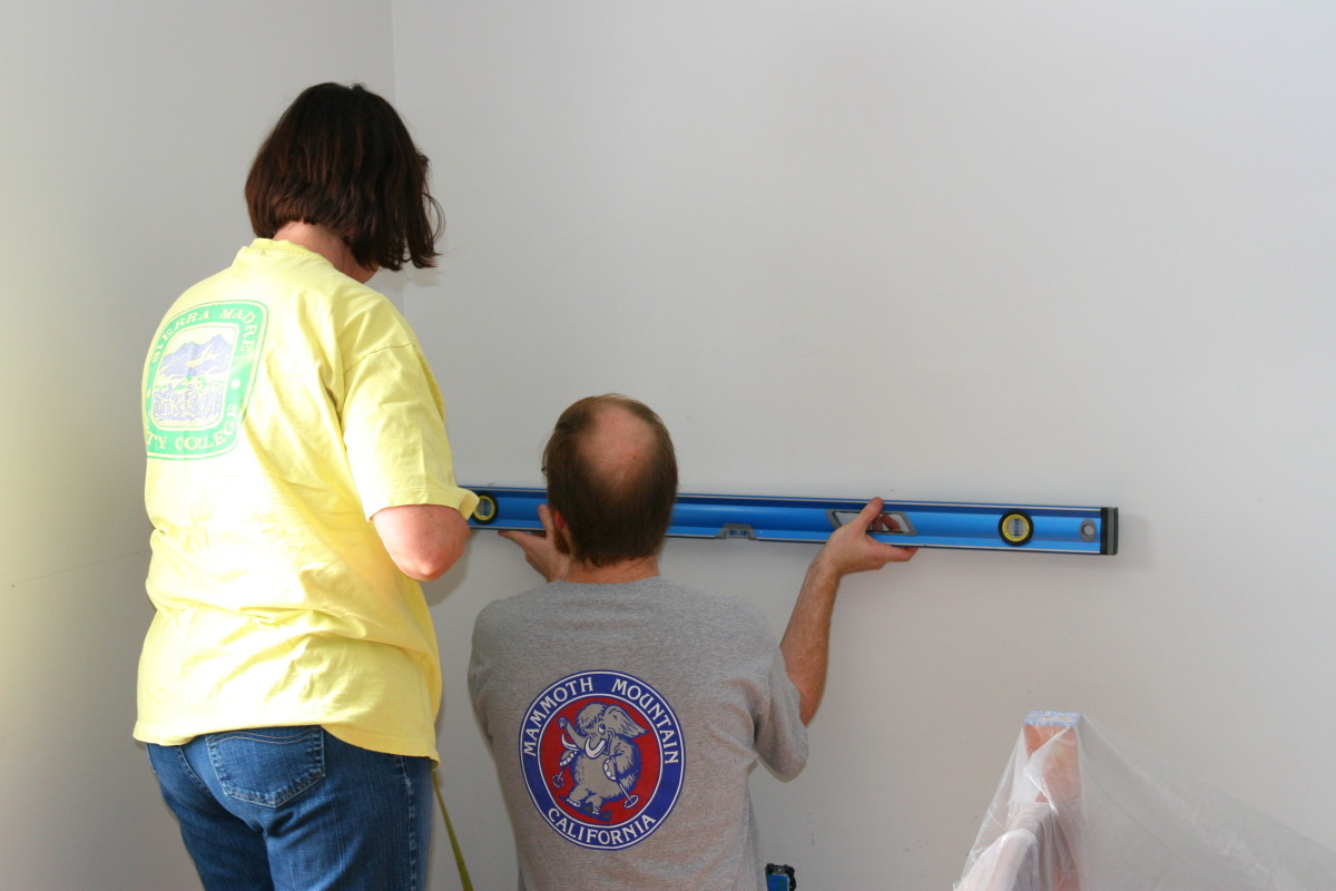 Marking the walls for the two-toned paint.
