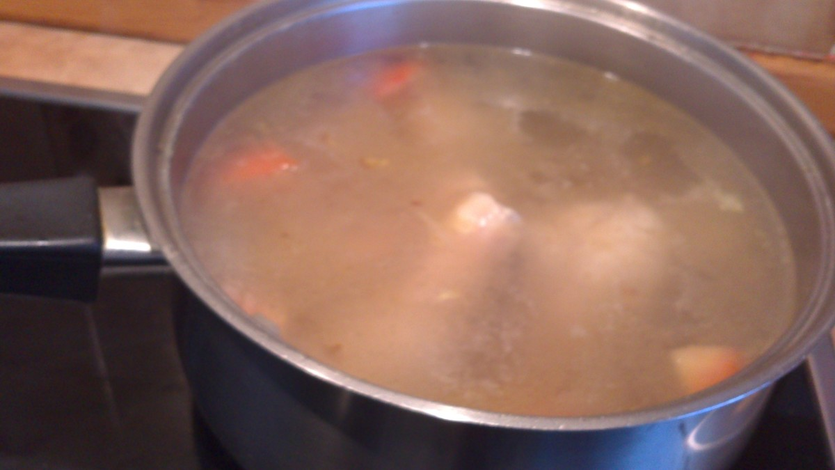 Adding the water to chicken legs