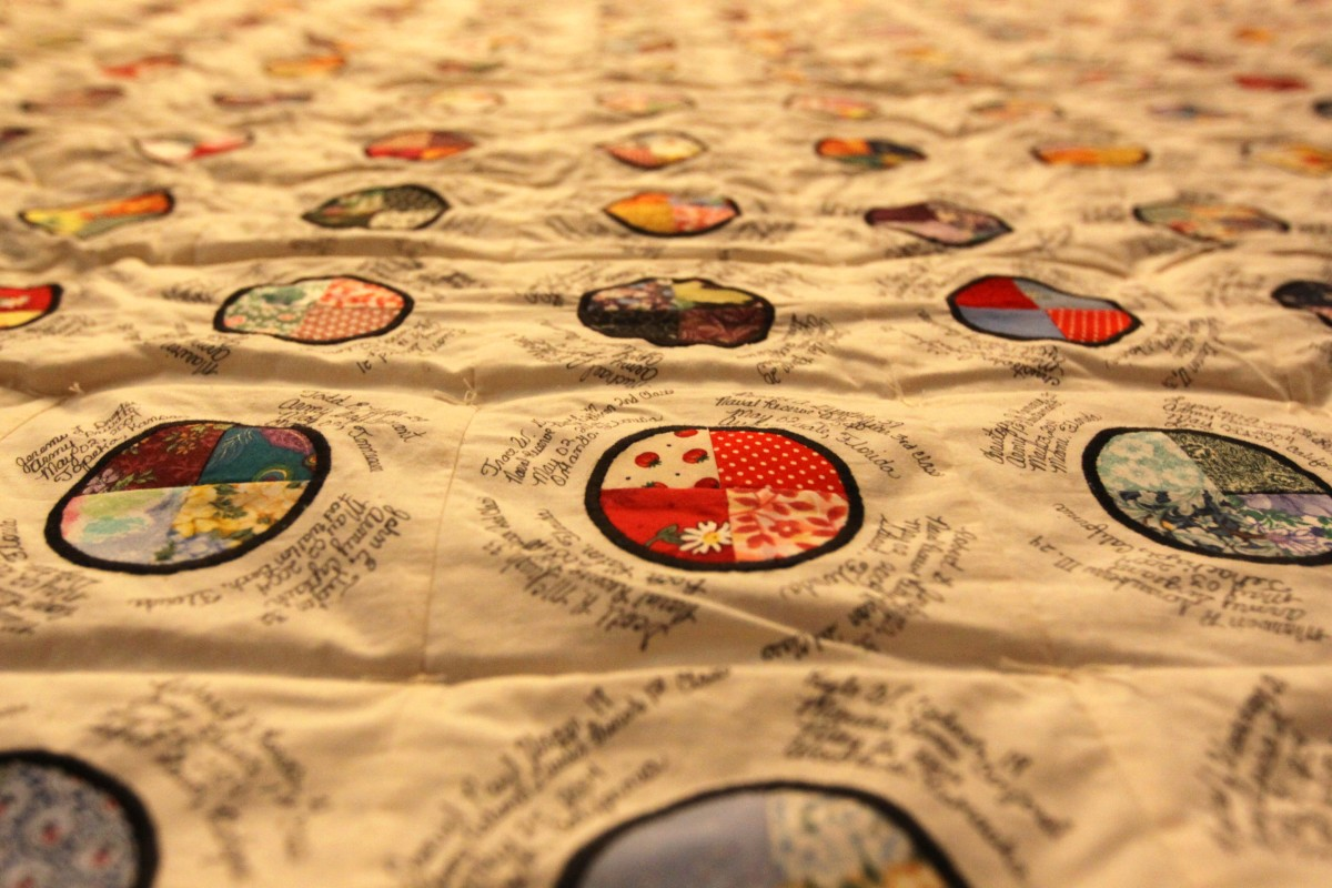 The names of 5,953 service members cover the beautifully-woven memorial quilts, which are displayed in honor of America's lost heroes at Camp Pendleton's South Mesa Club until Oct. 8. The eight World War II-inspired quilts were made by Elaine McDonal