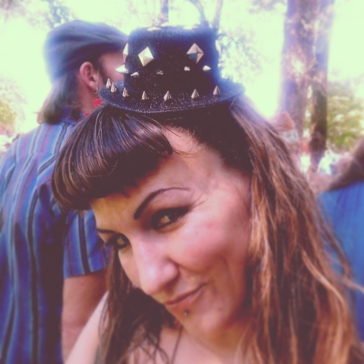 Rock short bangs with a Steam Punk mini top hat!
