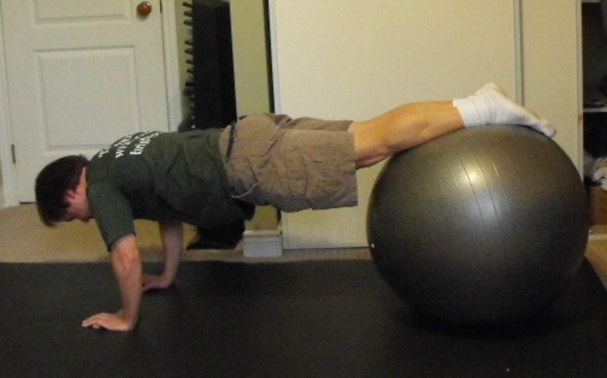 Doing planks on a stability ball.