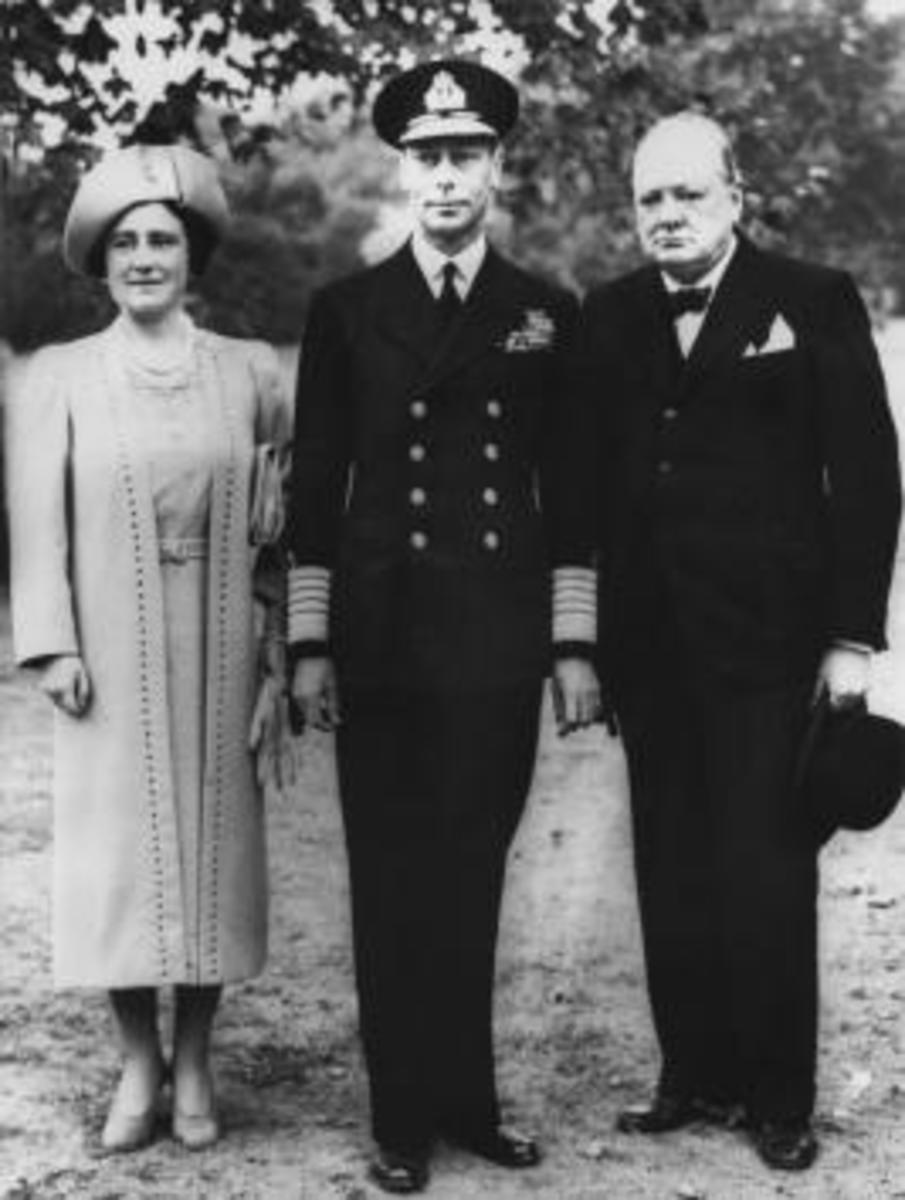 Britain's King George VI and Queen Elizabeth (the Queen Mother), accompanied by Prime Minister Winston Churchill, tour the grounds of Buckingham Palace on September 14, 1940, to inspect damage caused by German bombs that fell there.
