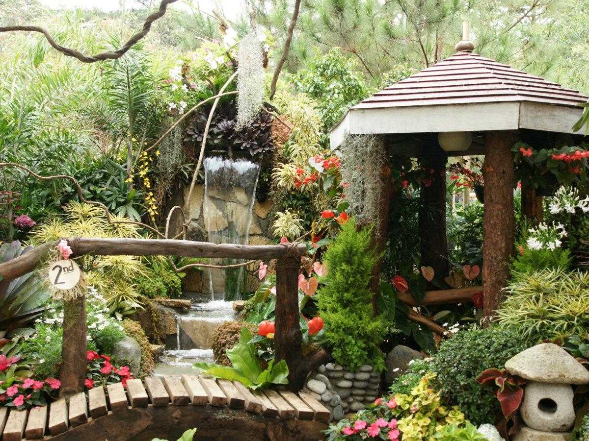 Garden accents complete a backyard oasis.