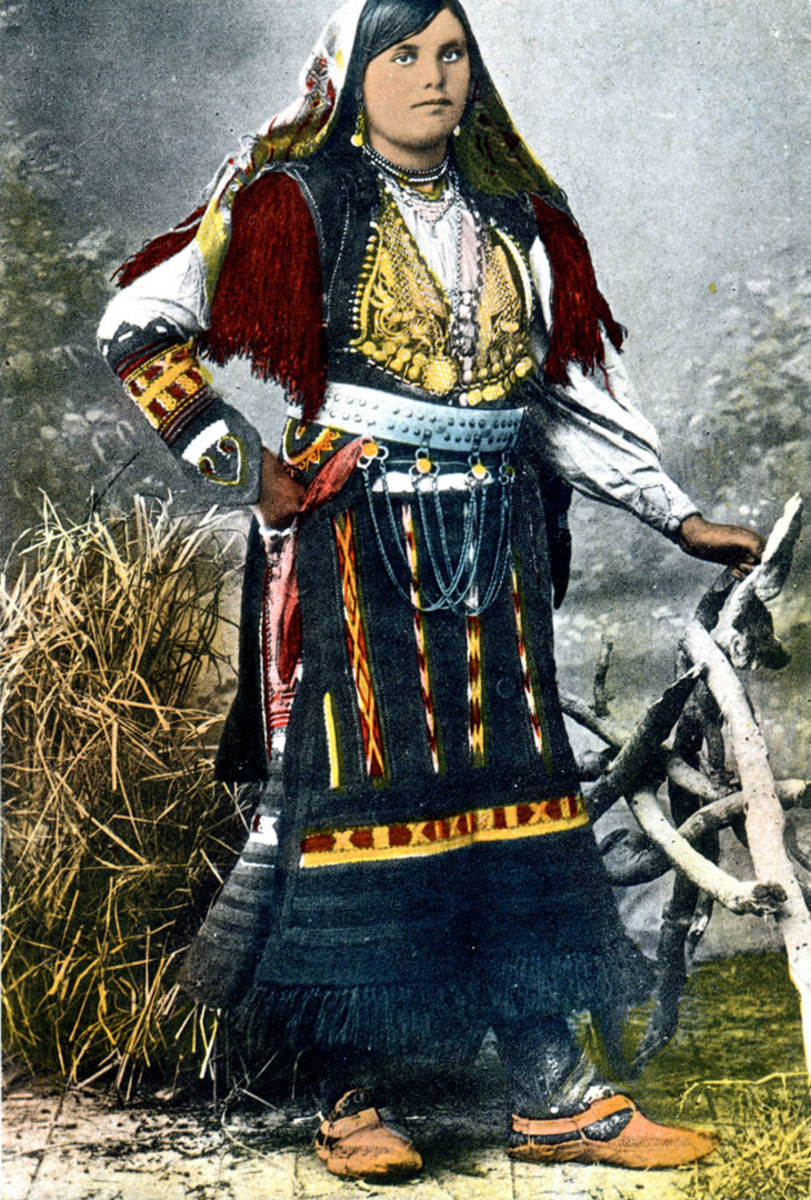 A proud Albanian woman in traditional dress. Photo from an early Albanian postcard.
