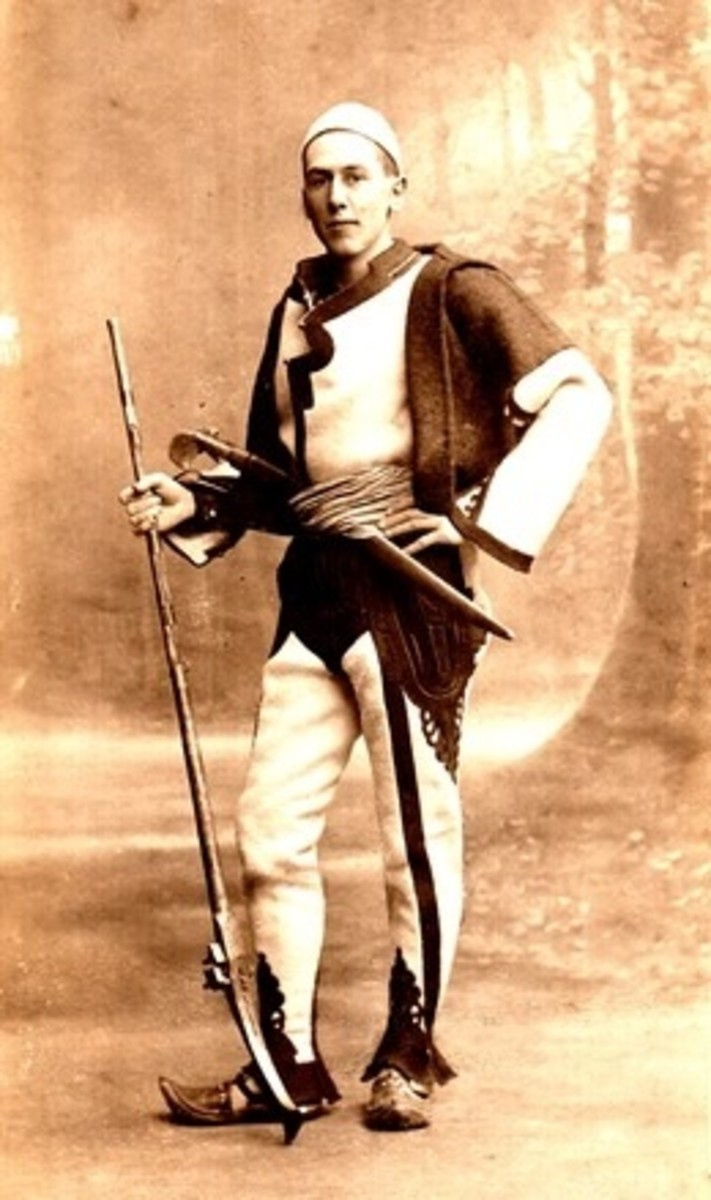 A young man in traditional Albanian war costume, circa 1913 (public domain image)