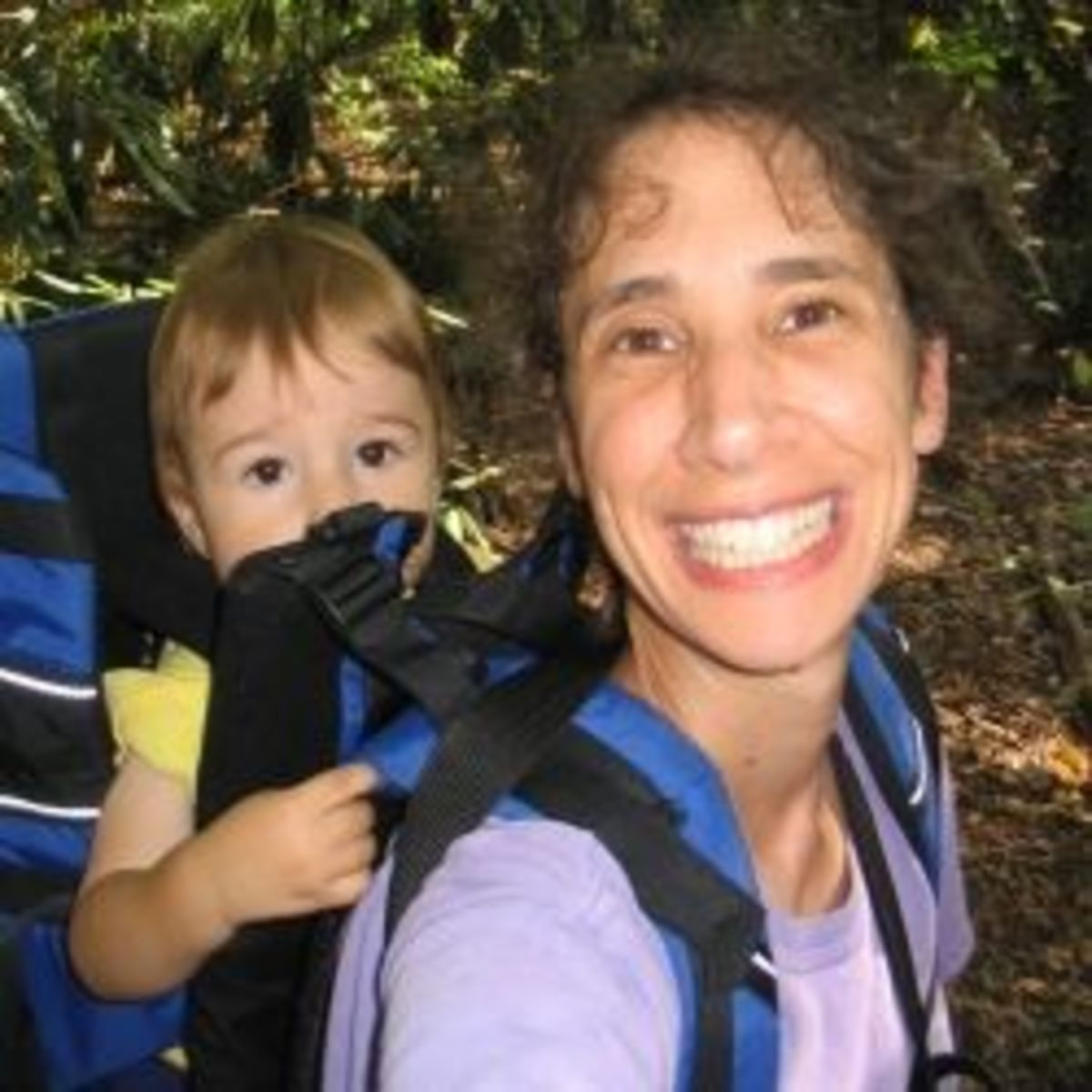 Hiking with my then-one-year-old in a backpack baby carrier.