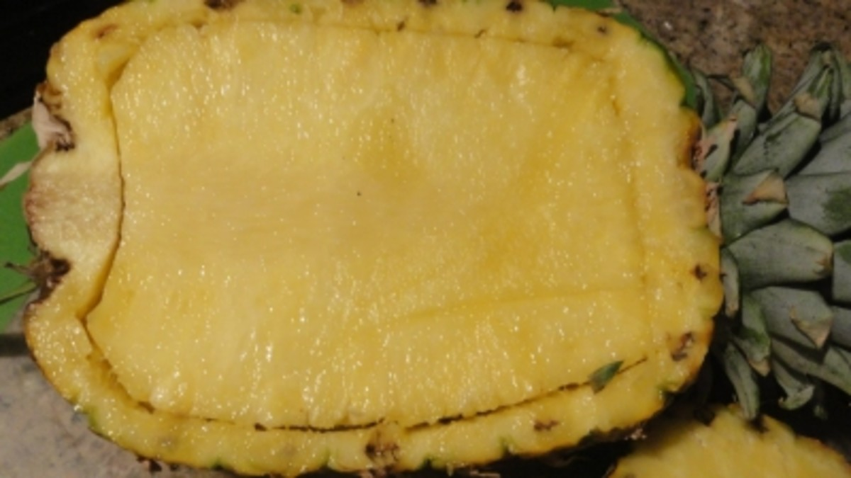 Cut the pineapple in half and run a knife around the edges.