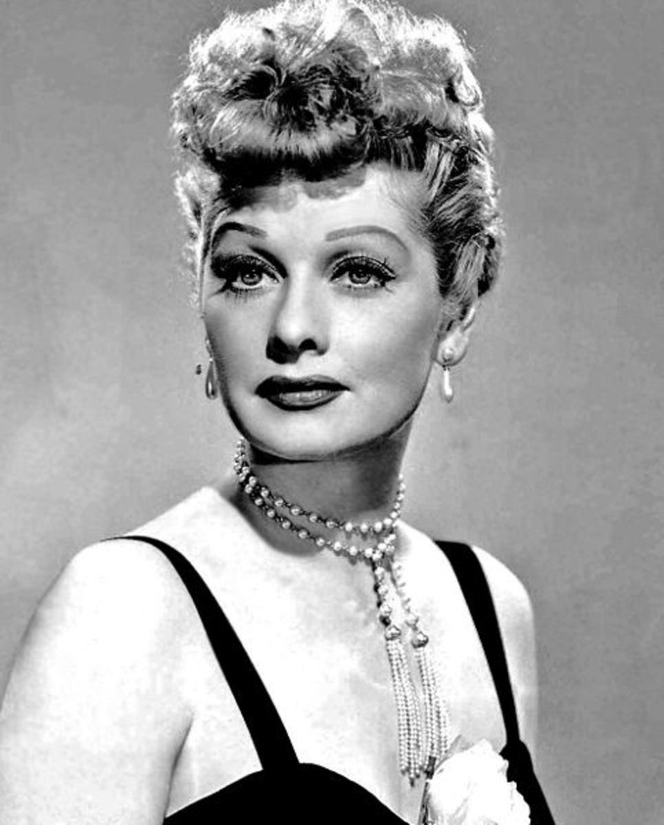 1950. On the cusp of two decades,  Lucille Ball wears an elaborate curly roll fringe.
