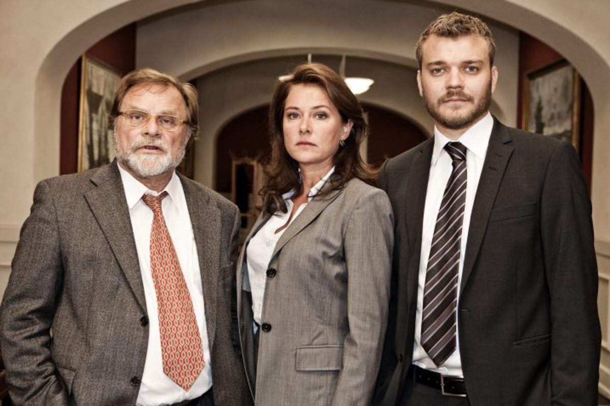 Sidse Babett Knudsen as Birgitte Nyborg with (right) Johan Philip Asbæk as Kasper Juul and (left) her mentor in the Moderates, Bent Sejrø (Lars Knutzon)