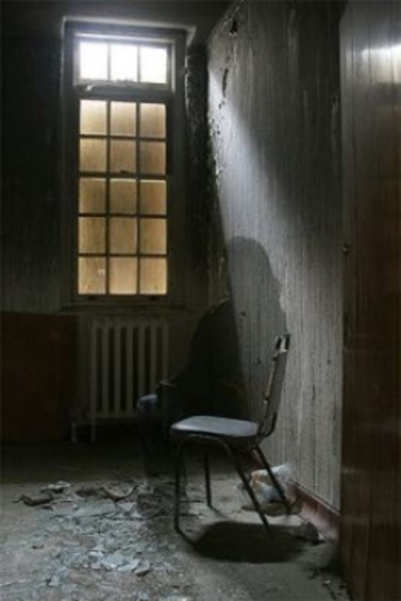 Here is a real photo we took of a ghost which we think is the ghost of a woman setting in a chair in the old closed down Unique Living Center that used to be near Fallston N.C.