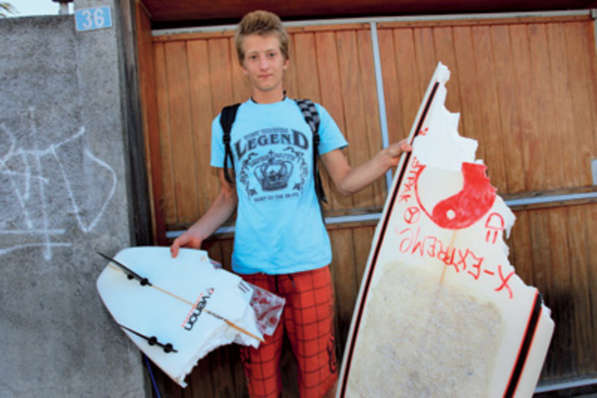 16 year old Arnaud Dussell with his broken surf-board