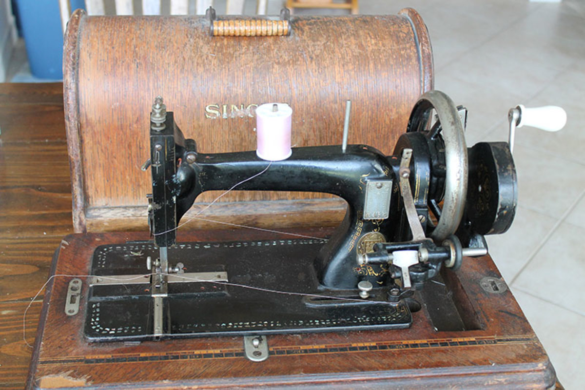 Singer Model 127 Portable hand crank machine.