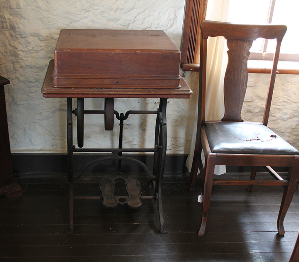 Older model double peddle treadle with a crank shaft.