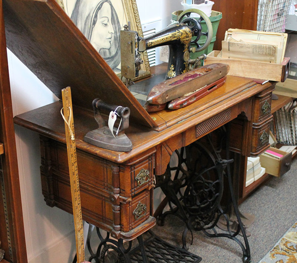 A Singer treadle with a fancy cabinet from the early 1900s