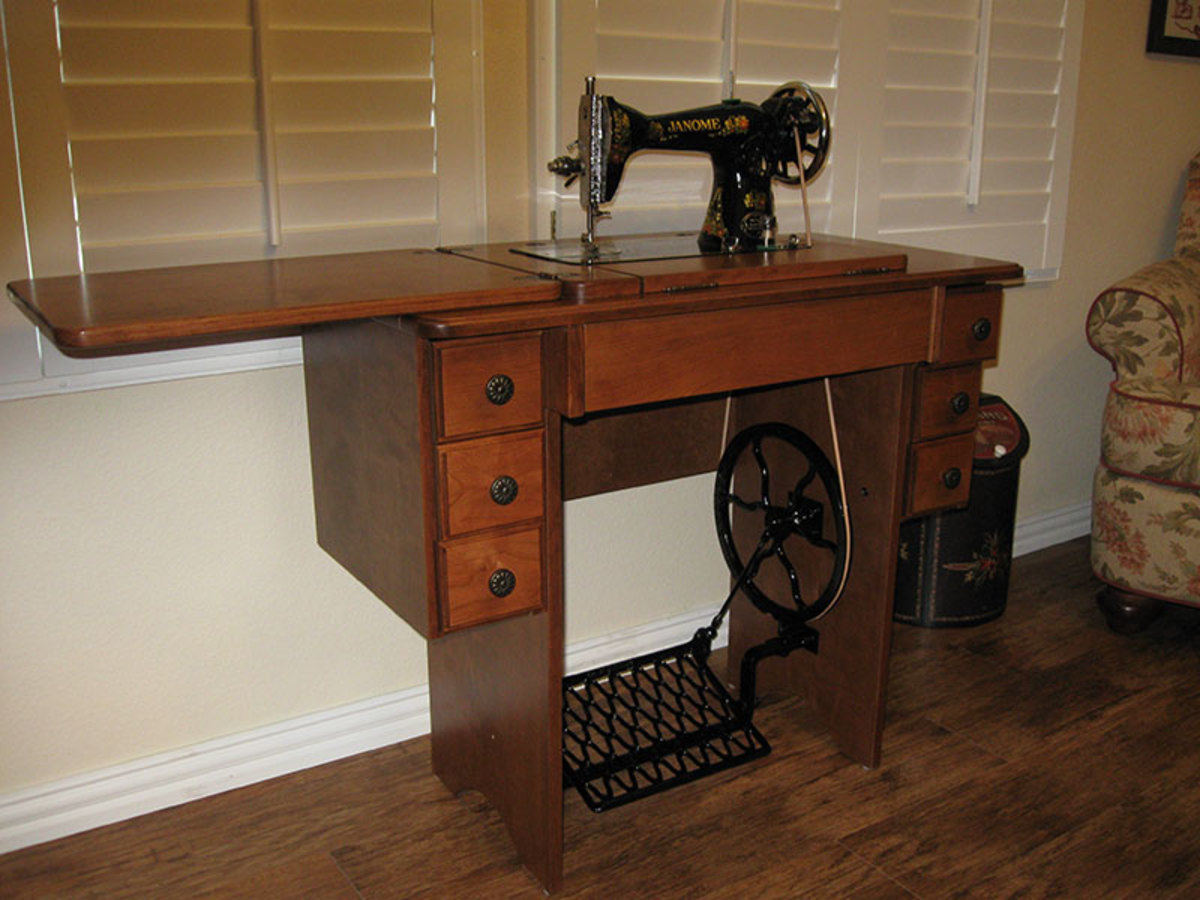 Reproduction cabinet with an older Janome treadle machine.