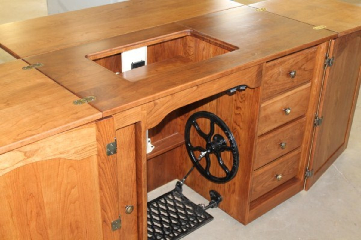 A new desk style Amish cherry cabinet with treadle.