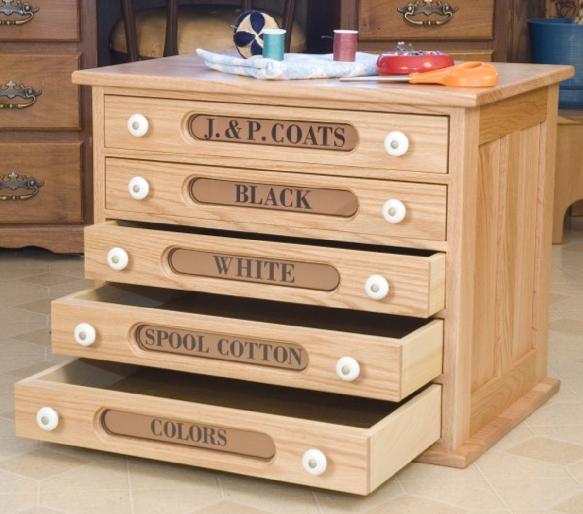 Reproduction spool cabinets from Cottage Craft Works make nice end tables and hobby and scrap book storage.