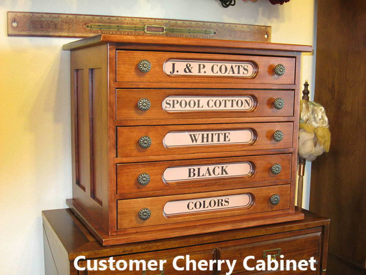 Reproduction spool thread cabinet in cherry from Cottage Craft Works is a popular sewing room organizer