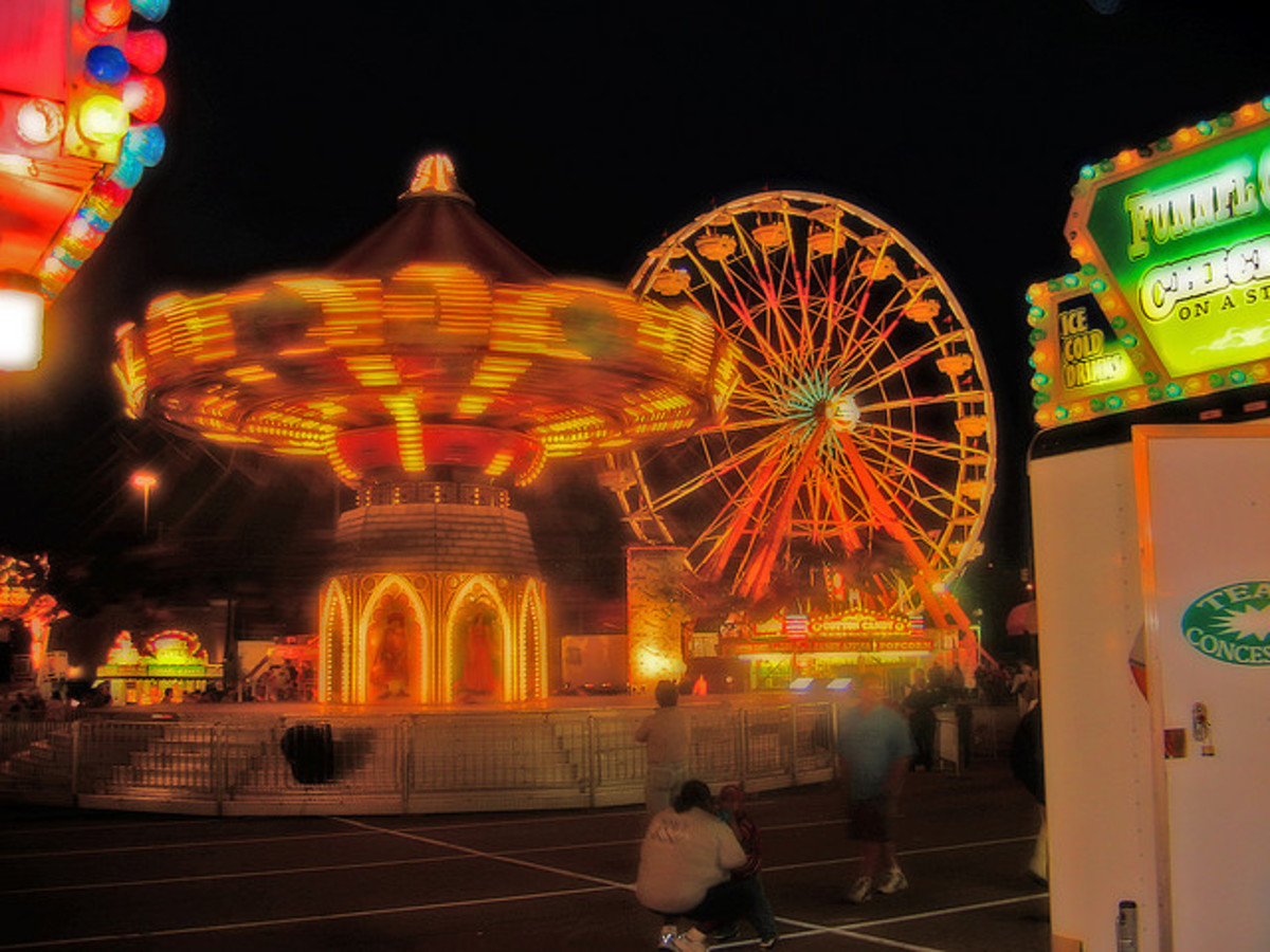 The spinning lights of a carnival at night is a unique beauty.