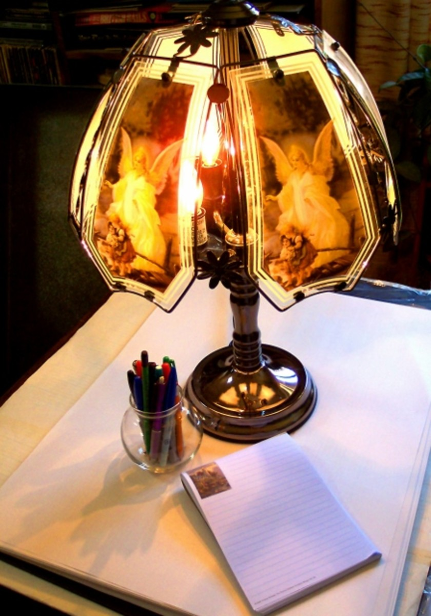 Writers are sometimes inspired by a pen, a pad, and a night lamp of floating angels.