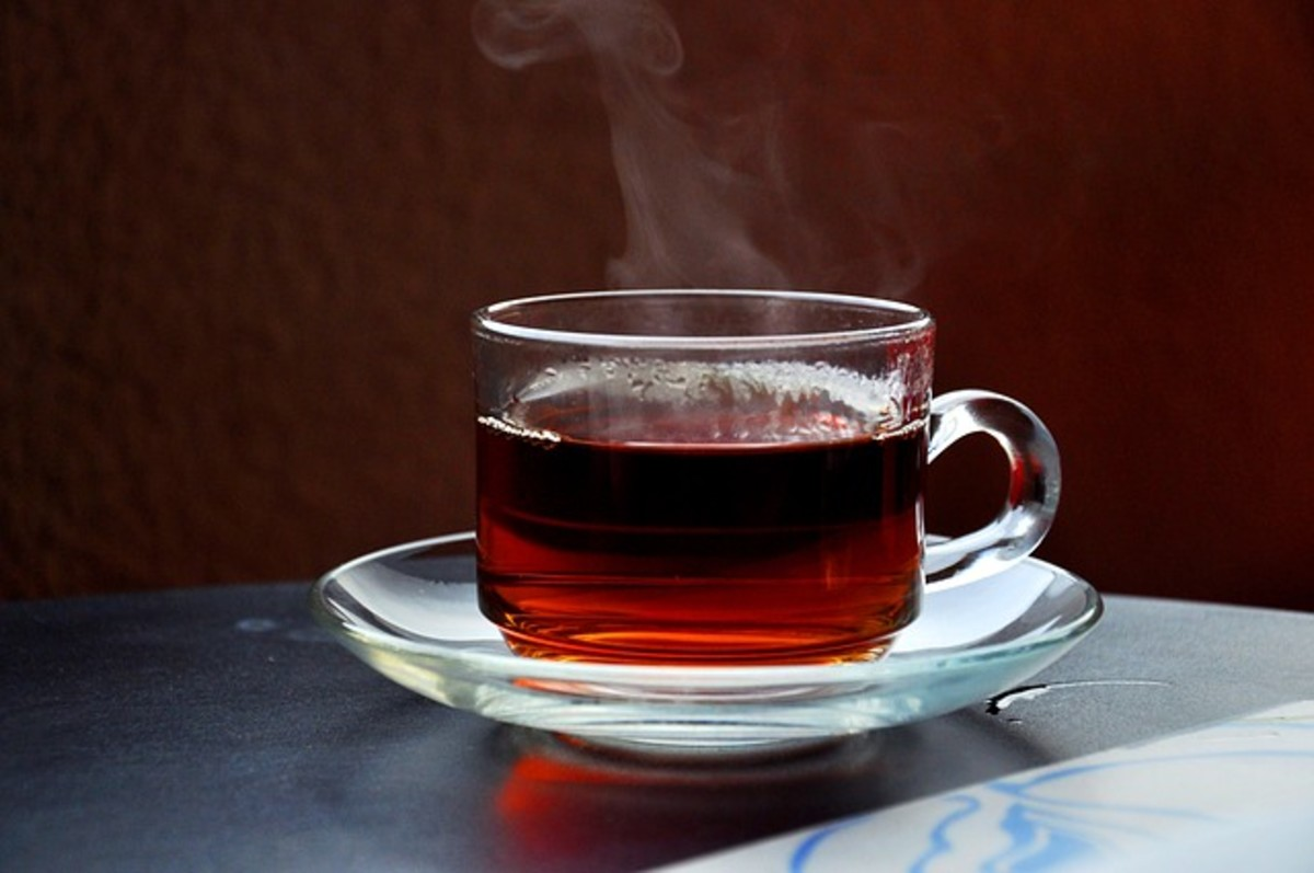 Hot tea relaxes the writer's mood in preparation for an evening write.