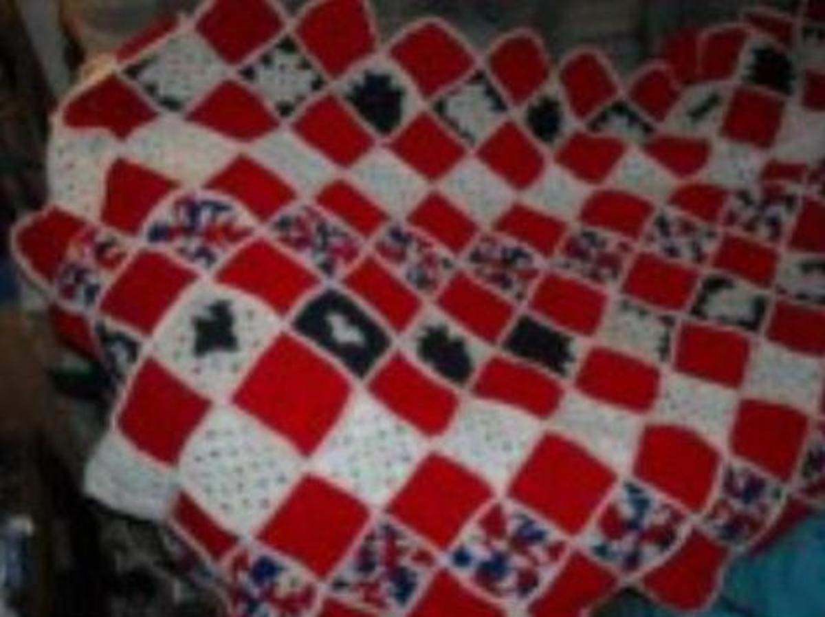 Granny Square Throws have been used for generations. Like this one using up scrapes of yarn left over from other projects creating a Red, White, and Blue beautiful throw.