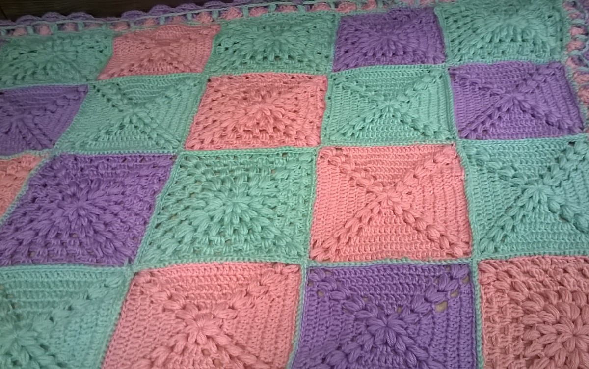 Here is an example of my own Hugs and Kisses Blanket Design. With X and O pattern all done using double crochet variety design