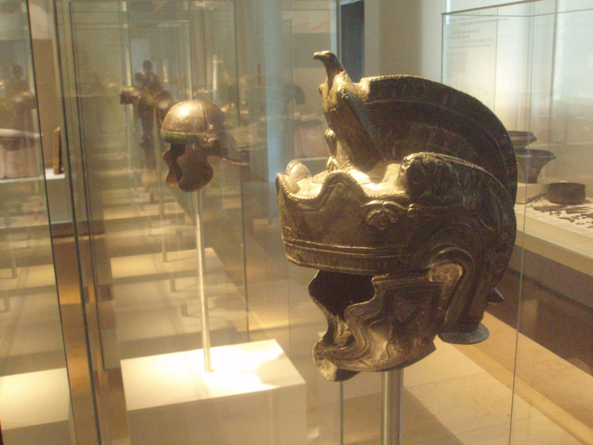 Roman helmets from the Upper Germanic limes, at the Germanisches Nationalmuseum in Nuremberg. Front: cavalry parade helmet, late 2nd century. Back: 2nd century infantry late Galea-type helmet.