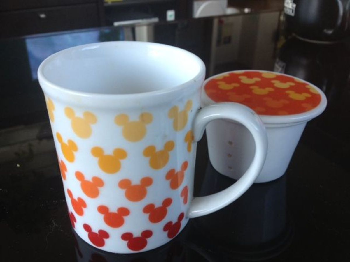 Tea mug with tea strainer and cover from Hong Kong Disneyland