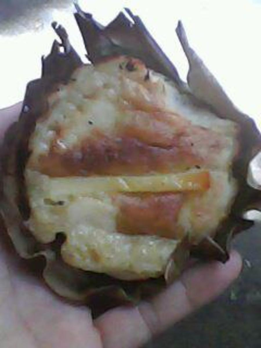 Bibingka, rice cake with slivered salted or freshly boiled eggs and ,usually prepared in a charcoal oven