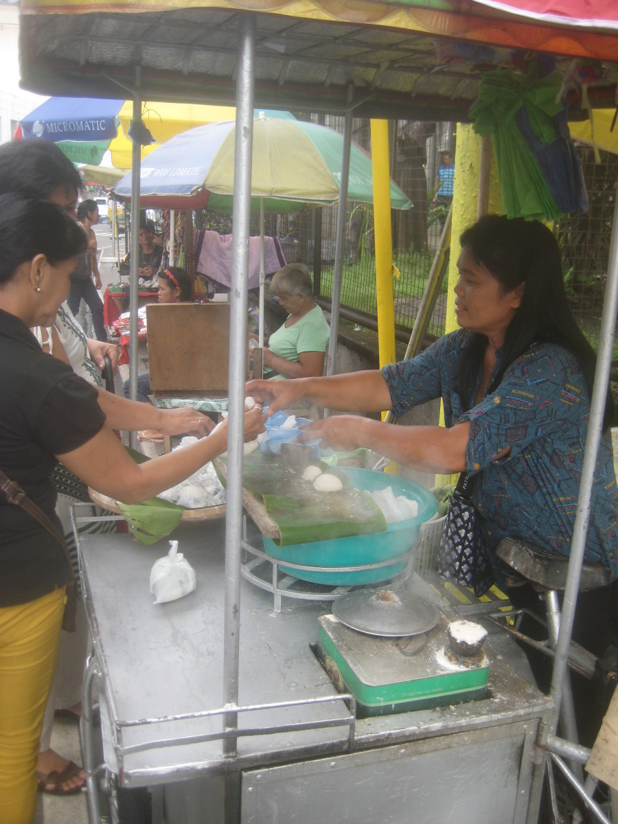 She's the only one selling rice cakes in Naga City, Bicol, Philippines, just outside the premises of San Francisco Church.