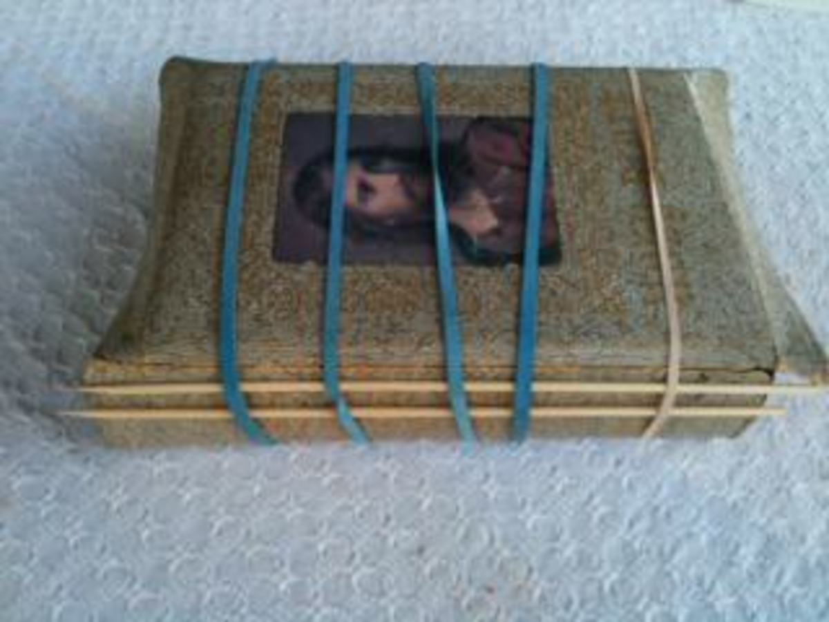 This is a Bible that I repaired for a friend. Rubber bands and bamboo skewers come in handy when making repairs to a book.