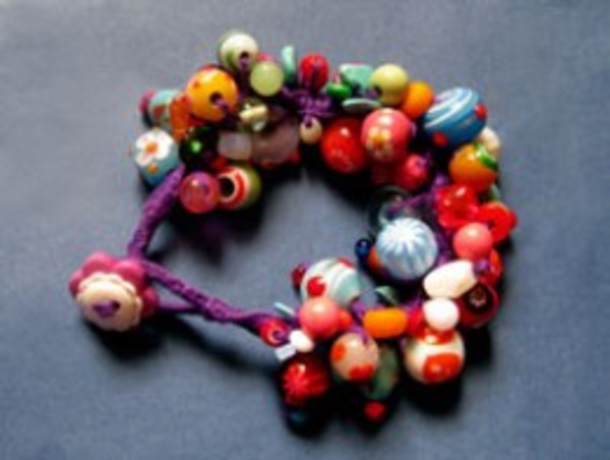 "I chose a ""Purple Carnival"" theme to assist in selecting bead colours for the bracelet."