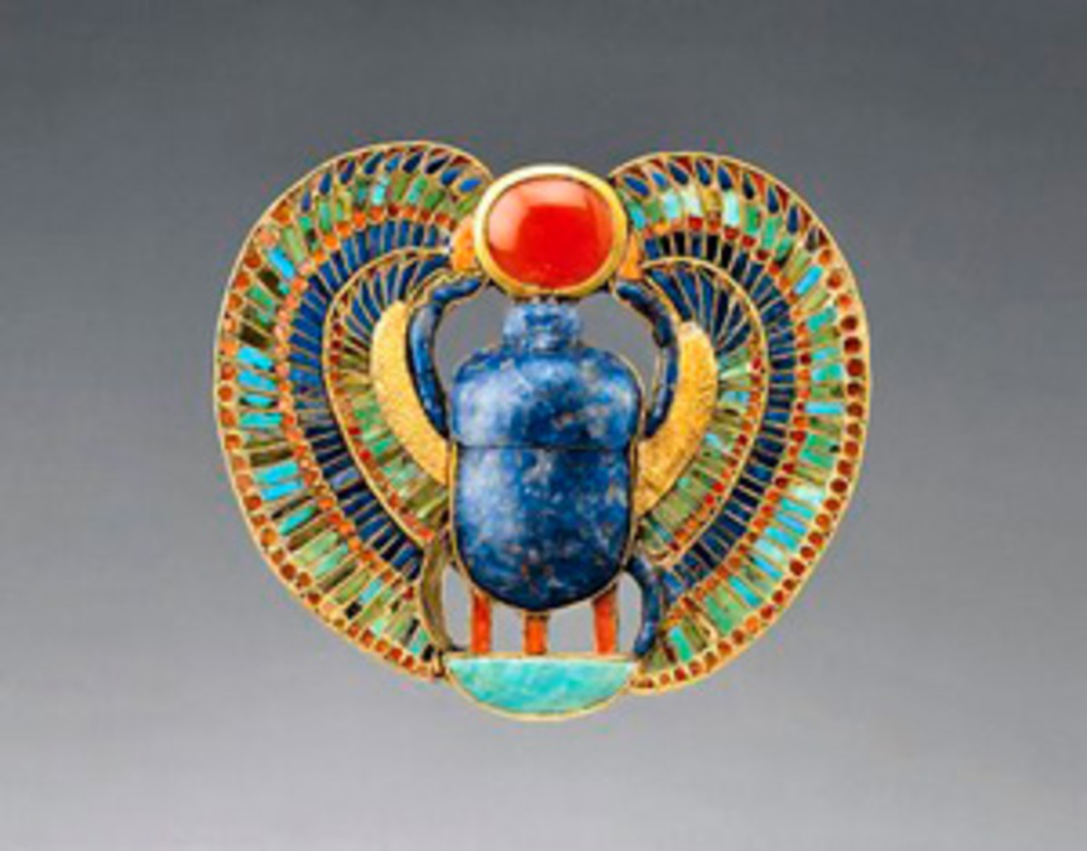 The scarab beetle in Egyptian jewellery symbolises rebirth, as the dung balls it creates form a birthing chamber for offspring. This pectoral was from the tomb of Tutankhamen.