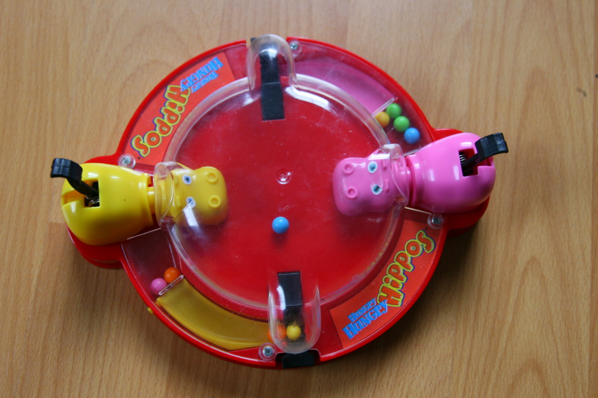 This travel Hungry Hungry Hippo game was a favorite  travel toy for our two year old.