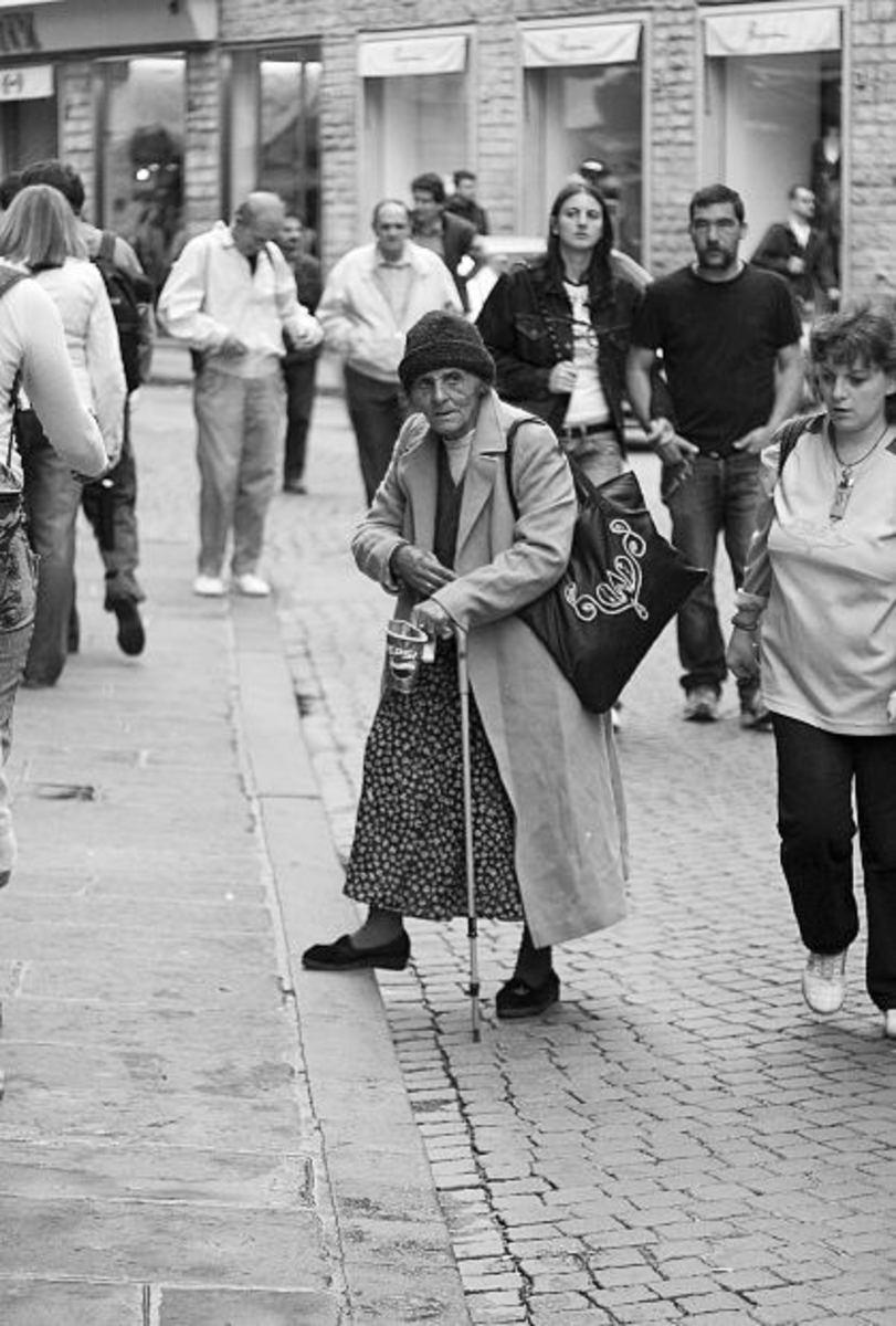 Elderly woman in a crowd